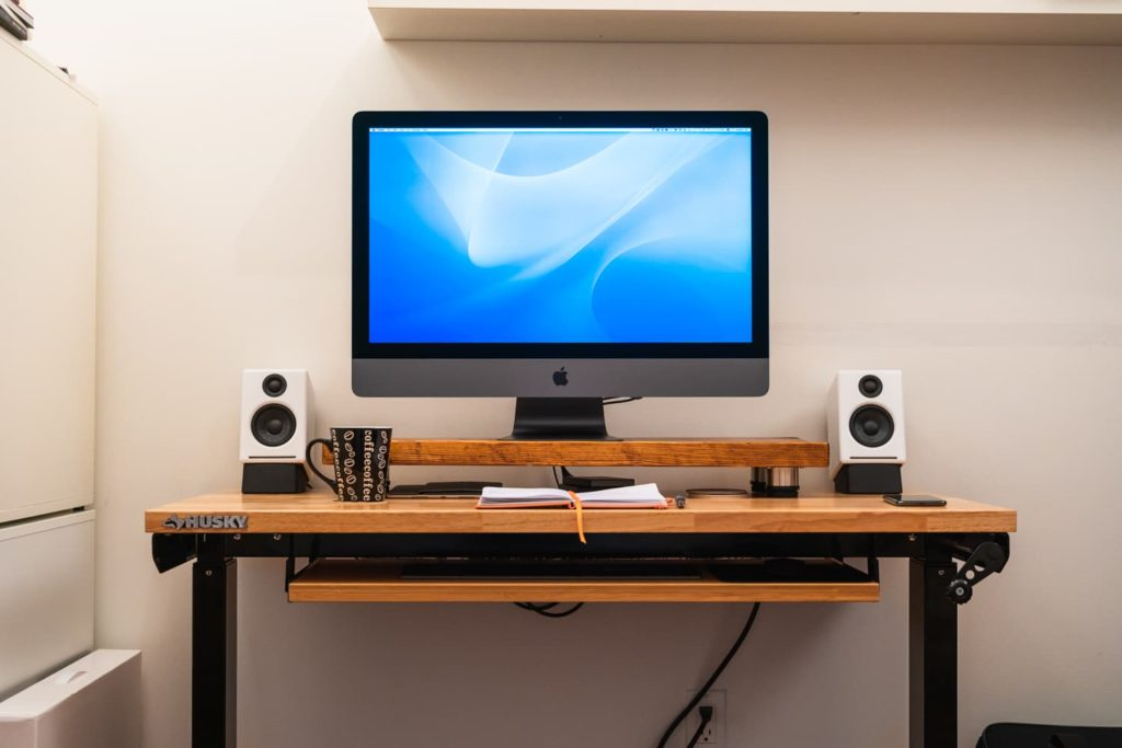 Image of a desk with an iMac on it.