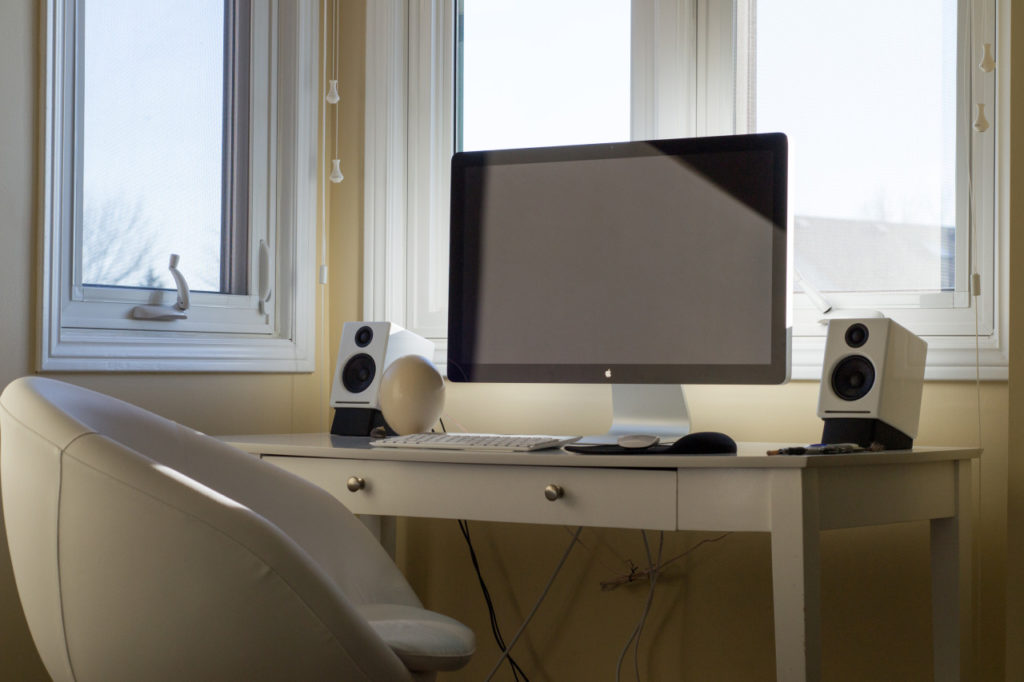 An image of a desk with a large monitor on it.